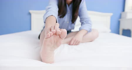 psoriasis : asian woman has athletes foot and itching her barefoot