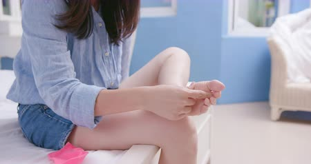 itch : asian woman has athletes foot and itching her barefoot