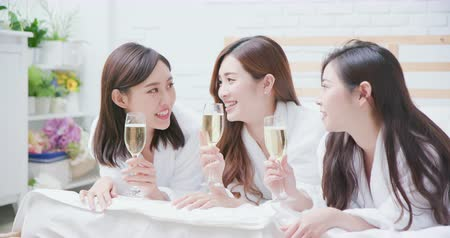 bestie : Smiling women friend with champagne in the spa salon or hotel Stock Footage