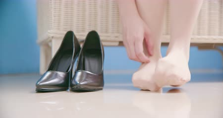 high heel shoe : business woman has athletes foot and itching her foot wearing socks