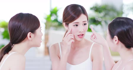natura : Smiling asian women friend are chat about the skin problem