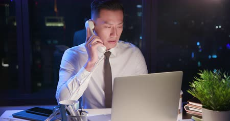 businesspeople : businessman overtime work and speak on the phone Stock Footage