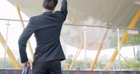 кулак : slow motion of businessman has fist gesture and cheer for himself