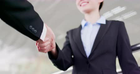 shaking hand : slow motion of Businesswoman handshake with confident smile after a meeting Stock Footage