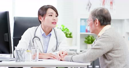 consulting : Female doctor see elder patient and console him not worry