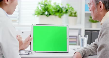 consulting : Female doctor explain disease and medicare with tablet in green screen Stock Footage