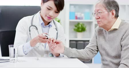 female measurements : Female doctor do blood sugar test for elder patient