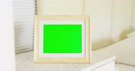 домашний интерьер : close up of photo frame with green copy space on table at home Стоковые видеозаписи