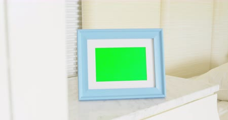 fotolijst : close up of blue photo frame with green copy space on table at home