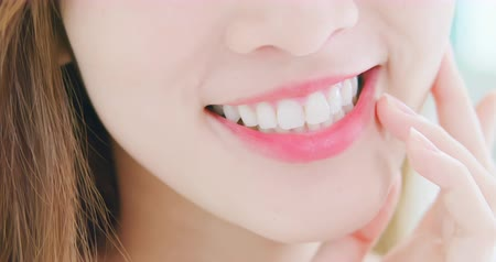 уход за кожей : slow motion close up of girl health teeth