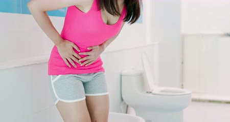 sní : asian woman feel pain with constipation in the restroom