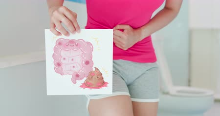 banquinho : asian woman hold cartoon billboard about intestine and blood stool in wc