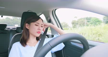 driverless : Asian woman sleep and yawn in an autonomous self driving car
