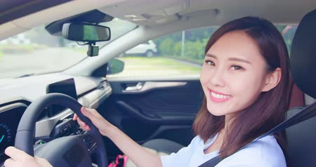 prawo jazdy : pretty asian woman sit in the car and smile happy