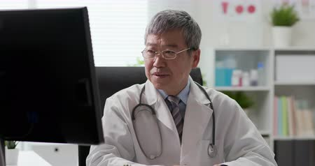 disappointment : Senior asia doctor feel tired and has headache Stock Footage
