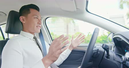 self driving : business asian man feel experience to drive an self-driving smart car Stock Footage