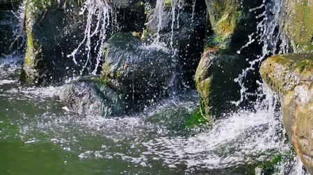 liken : slow motion of mountain stream among the mossy stones