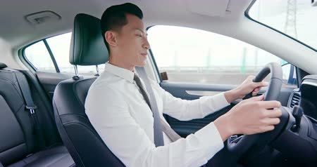 auta : business asia man driving happily in the car on highway