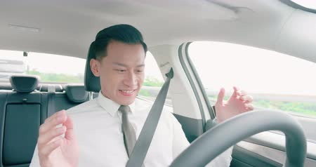 autonomous car : business asian man feel amazing and enjoy to drive an auto self-driving smart car in highway Stock Footage