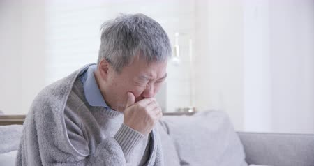 lung : old asian man get a cold and cough at home