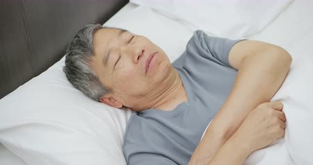 aposentar : asian elder man snores when he sleeps at night