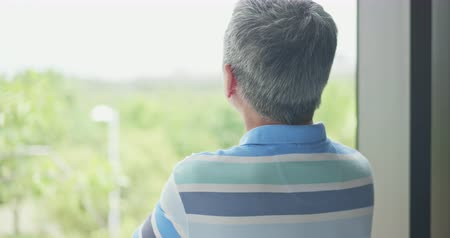 issues : asian elder man worry something and look through window
