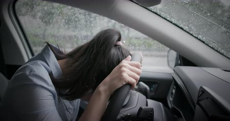 sós : asian woman feel depressed and cry in the car