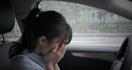 crush : asian woman feel depressed and cry in the car