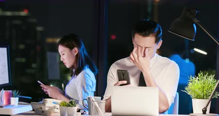 ferido : asian businessman feel eye and shoulder pain in the office when using smartphone