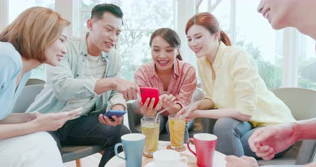 group people : asian woman and man watch something on smart phone happily Stock Footage