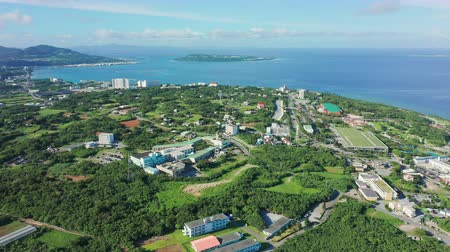 japonya : Okinawa, Japan - Aug 16 , 2019 : Aerial shot of Ocean Expo Park and Churaumi Aquarium