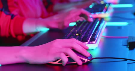 close up of cyber sport gamers team play game while clicking the mouse and keyboard