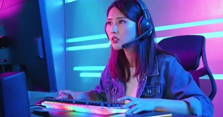 Young asian esport gamer girl feel angry while playing in Online Video Game because of keyboard is stop working Stock Footage