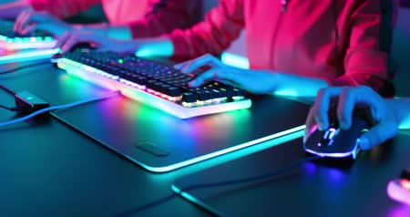 close up of pan asian cyber sport gamers team play game while clicking the mouse and keyboard Stock Footage