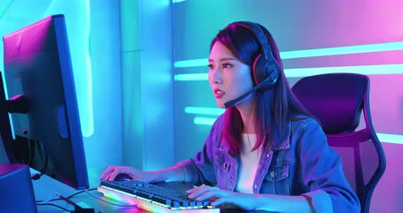 Young Asian Pro Gamer Girl Playing in Online Video Game