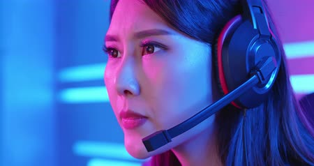 esports : close up of Young Asian Pretty Pro Gamer Playing in Online Video Game