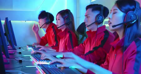 microphone : Team of asian teenage cyber sport gamers lose the multiplayer PC video game on eSport tournament and feel upset Stock Footage