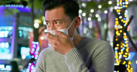 zsebkendő : asian man feel sick and cough sitting on the outdoor chair Stock mozgókép
