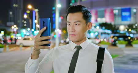 face id : Asian businessman use facial recognition system by smartphone at night