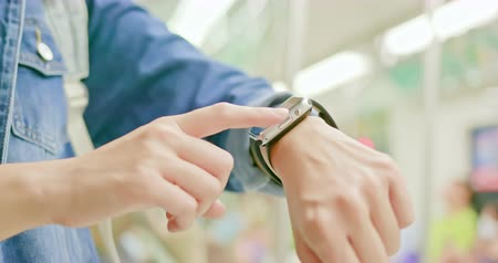 portable information device : close up of asian woman use her wearable smart watch on the train Stock Footage