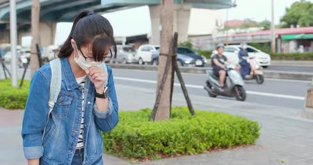 zsebkendő : asian woman feel sick and cough outdoor