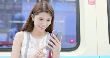 metro : asian young woman use 5g smartphone in the metro train-location taipei and taiwan
