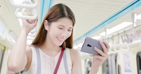taipei : asian young woman watch video by 5g smartphone in the subway or train-location taipei and taiwan Stock Footage