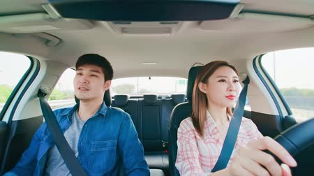 машины : asian couple driving happily in the car on highway