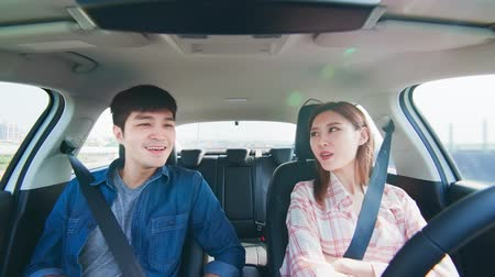 self driving : Asian couple experience to riding an autonomous self driving car in highway