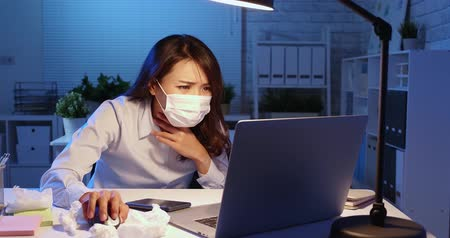 discomfort : sick asian business woman work overtime and has cough in the office