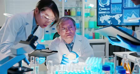 supervisor : asian scientist team meeting and writing analysis results in the laboratory Stock Footage