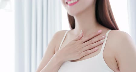 cuidados com a pele : asian beauty apply cream on chest and smile Stock Footage