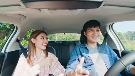 driverless : Asian couple experience to riding an autonomous self driving car on the road Stock Footage
