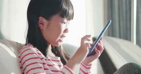 phone entertainment : close up of asian cute girl use smart phone on the bed at home Stock Footage